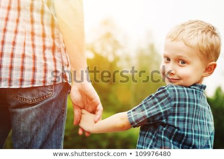 boy in fathers clothes stock photo © is2