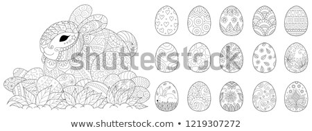 Rabbit and colored egg symbol of Easter. Set holiday silhouette Stock photo © orensila