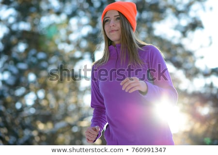 young woman running in beautiful winter forest at sunny frosty day active lifestyle concept stock photo © maxpro