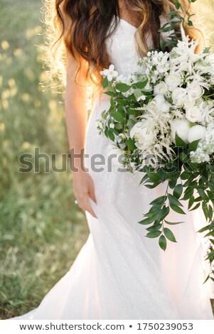 Gyengéd menyasszony pózol elegáns ruha esküvői csokor Stock fotó © LightFieldStudios