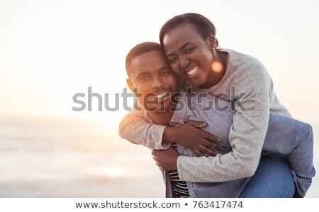 Homme petite amie permanent plage nature Photo stock © wavebreak_media