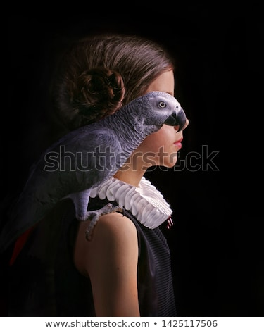 Beautiful young lady with a parrot on a shoulder Stock photo © konradbak