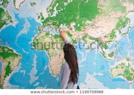 Geography Teacher Points to the Globe Stock photo © Voysla