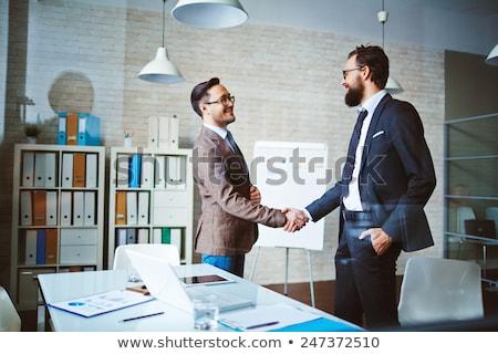 businessmen handshaking after deal agreement stock photo © boggy