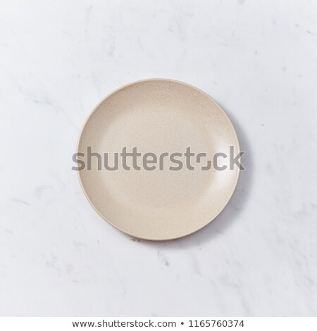 Clay handcraft empty bowls, plates, covered with glazed , place under text on a gray wooden backgrou Stock photo © artjazz