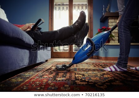 woman with tablet pc and vacuum cleaner at home Stock photo © dolgachov