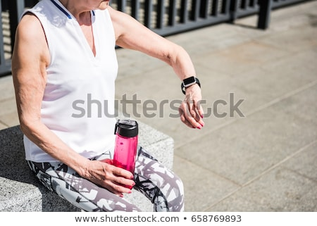 woman with fitness tracker doing sports Stock photo © dolgachov