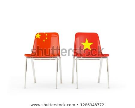 Twee stoelen vlaggen China Vietnam geïsoleerd Stockfoto © MikhailMishchenko