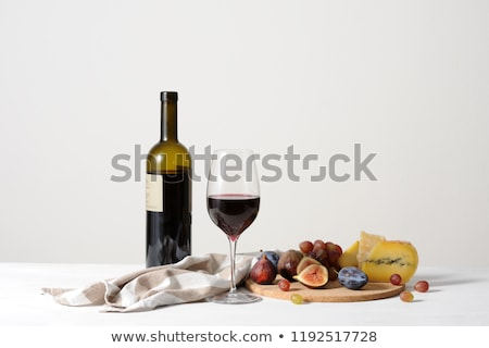 red plums in a cork plate stock photo © homydesign