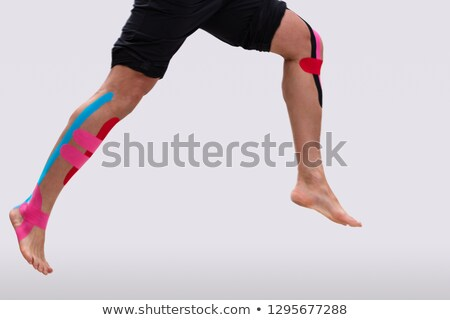 Man With Physio Tape Running Over White Background Stock photo © AndreyPopov