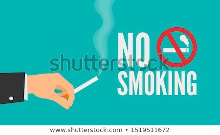 Affaires cigarette main costume Photo stock © ra2studio