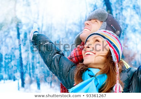 Stock photo: Happy Young Couple in Winter Park having fun.Family Outdoors. love