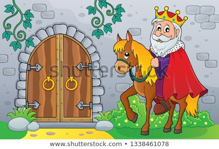 king on horse by old door theme image 1 stock photo © clairev