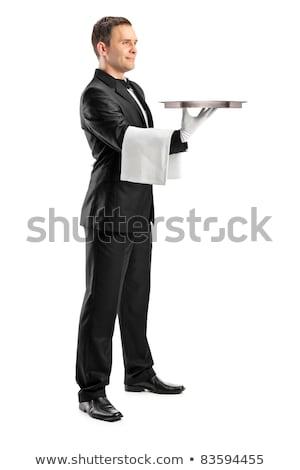 Portré jóképű fiatal pincér csokornyakkendő mutat Stock fotó © deandrobot