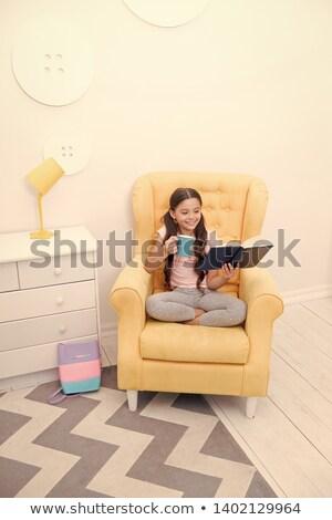 Bambina giallo pigiama bere latte illustrazione Foto d'archivio © colematt