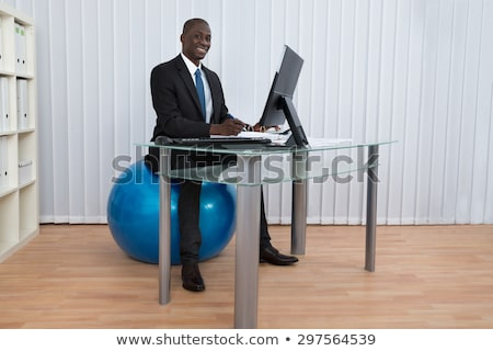 Businesspeople Working In Office Sitting On Fitness Ball Stock photo © AndreyPopov