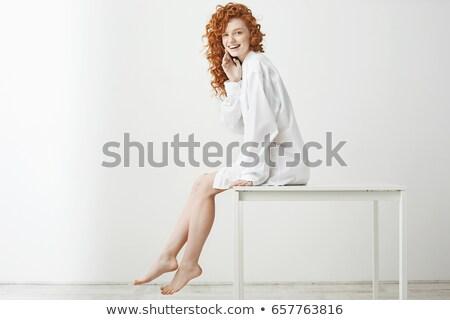Pozitív vonzó vörös hajú nő lány göndör haj ül Stock fotó © pressmaster