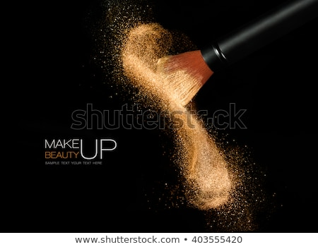 Beauty and cosmetics concept. Makeup brush on black background Stock photo © serdechny