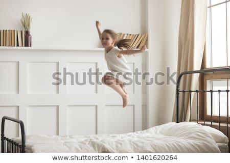 Radosny energiczny aktywny dziewczynka skoki wysoki Zdjęcia stock © Giulio_Fornasar