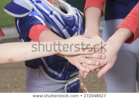 A baseball team puting hand together Stock photo © Lopolo