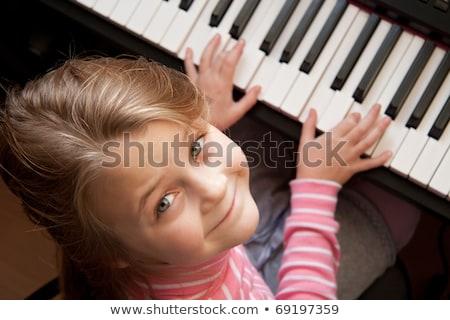 Jeune fille jouer numérique piano salon enfant Photo stock © Lopolo