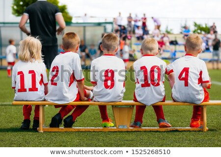Sports team on the wooden bench during the youth tournament on a sunny summer day Stock photo © matimix