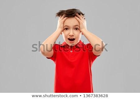 shocked little boy in red t-shirt touching head Stock photo © dolgachov