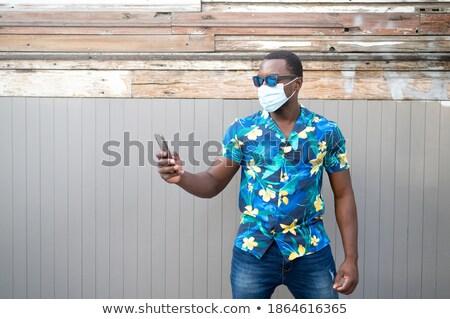 Hombre mascarilla quirúrgica empresario gris Foto stock © nito