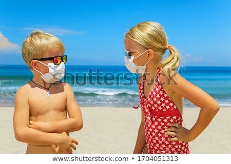 Homem máscara cirúrgica praia caucasiano azul Foto stock © nito