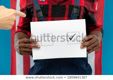 Female laborer showing sign for message Stock photo © photography33