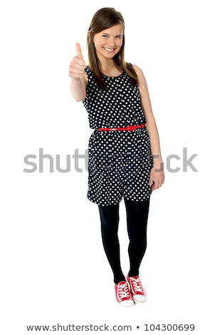 Glamorous teenager gesturing thumbs-up Stock photo © stockyimages