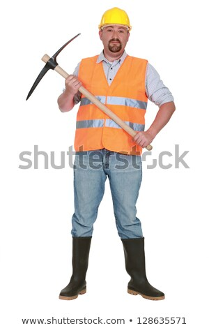 bricklayer holds pickaxe against studio background Stock photo © photography33