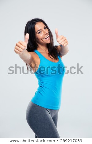 smiling fitness woman showing thumb up stock photo © rob_stark
