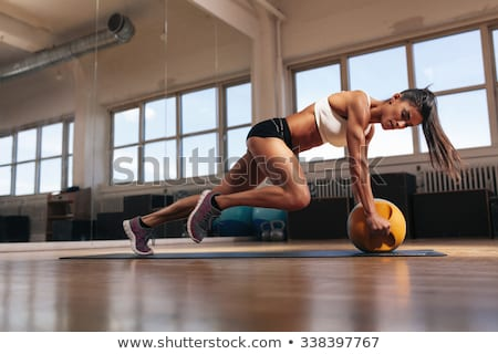 Fitness woman training crossfit with kettlebell stock photo © Maridav