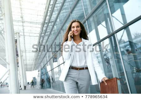Happy Business woman talking on mobile phone. Fashion elegant wo Stock photo © Victoria_Andreas