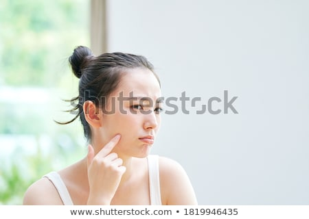 woman touching her face skin stock photo © dolgachov