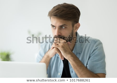 Concerned Businessman in front of laptop Stock photo © Rugdal