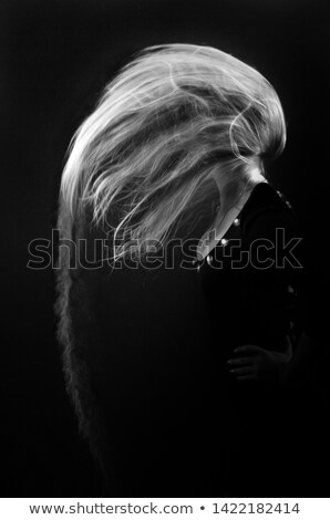 woman face behind flying hair Stock photo © chesterf