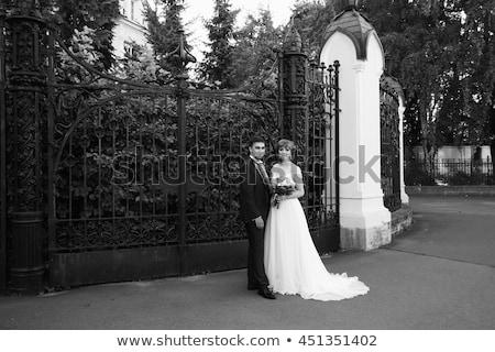 couple standing near lattice Stock photo © chesterf