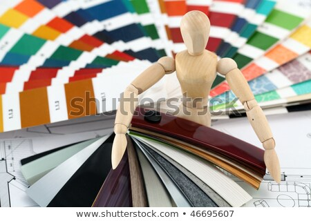 wooden man & palettes of colors designs stock photo © Vladimir