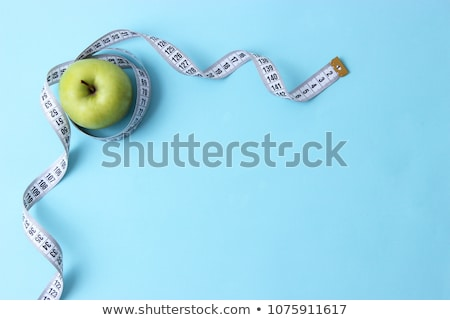 Fruits and measurement tape on the white background Stock photo © tannjuska