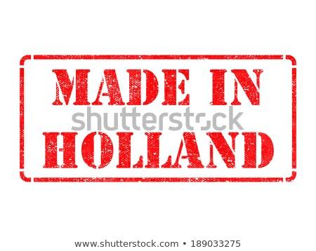 Made in Holland - inscription on Red Rubber Stamp. Stock photo © tashatuvango