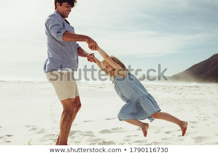 Stock photo: Father and daughter on beach
