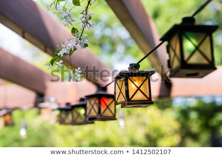 Lanterns in a summer pavilion Stock photo © Arrxxx