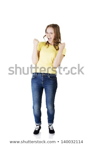 Young woman punching the air and laughing Stock photo © bmonteny