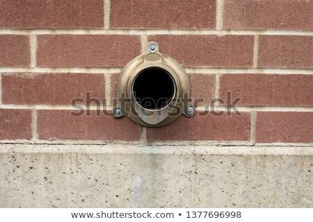 Brass Gutter downspout Stock photo © bobkeenan