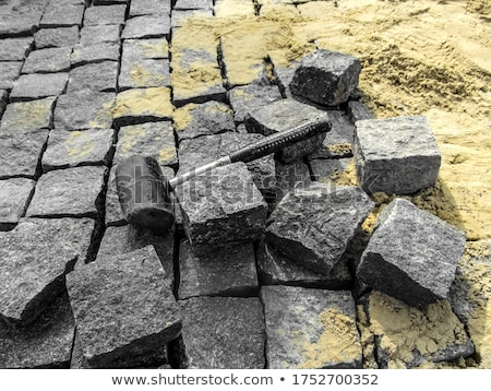 Paving works with new granite stones Stock photo © haraldmuc