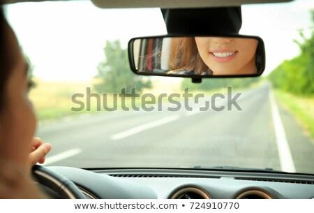 Női arc autók hátsó nézet tükör vezetés Stock fotó © stevanovicigor