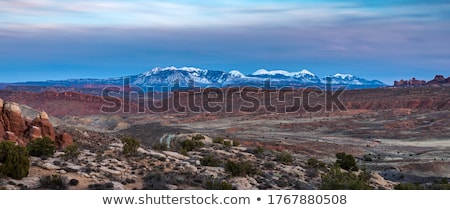 Snowcapped Mountains and Rock Formations at Arches National Park Stock photo © meinzahn