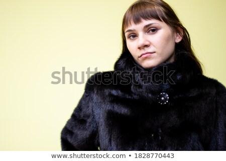 Belo morena mulher casaco de pele isolado preto Foto stock © Victoria_Andreas